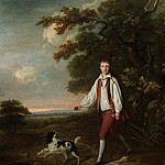 Portrait of a youth holding a cricket bat and ball with his pet black and white springer spaniel, Al Black