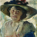 Woman in a hat with roses