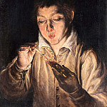 A boy lights candles
