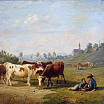 Cows on pasture with shepherd boy