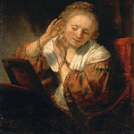 A Young Woman Trying on Earings, Rembrandt Harmenszoon Van Rijn