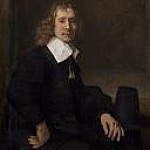 Rembrandt Harmenszoon Van Rijn - A Young Man Seated at a Table