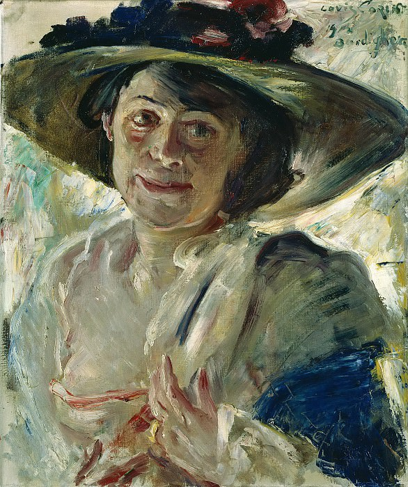 Woman in a hat with roses. Lovis Corinth