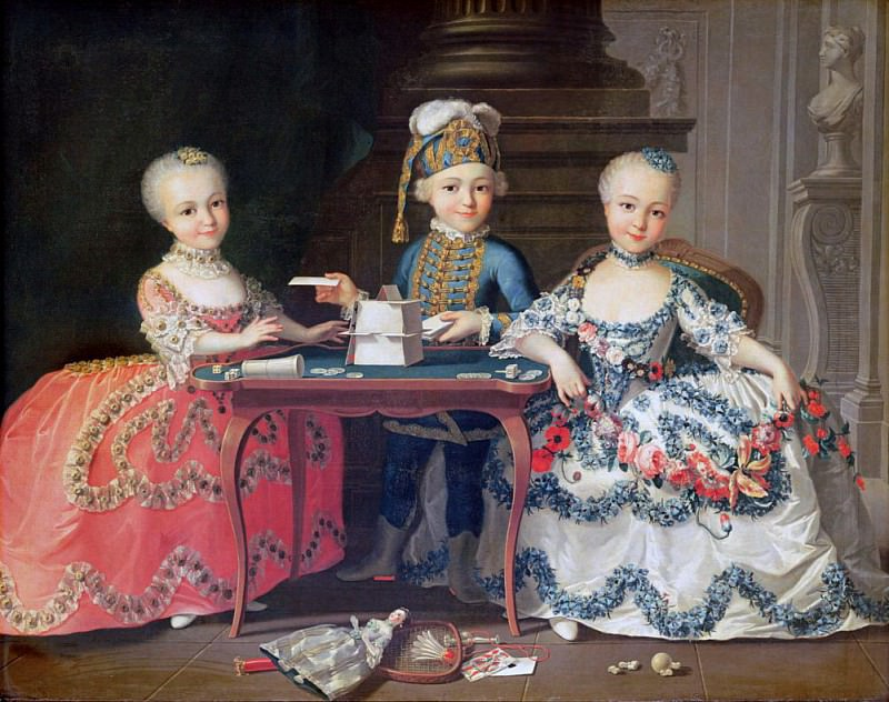 Group portrait of a boy and two girls building a house of cards with other games by the table. Francois-Hubert Drouais