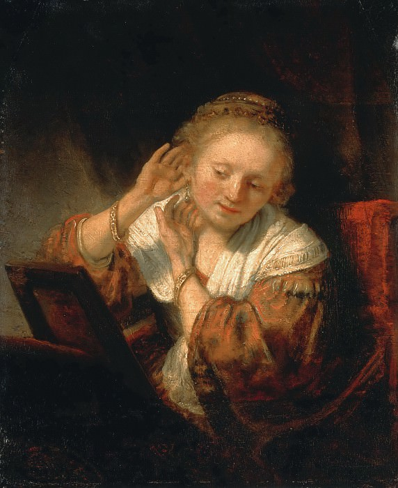 A Young Woman Trying on Earings. Rembrandt Harmenszoon Van Rijn
