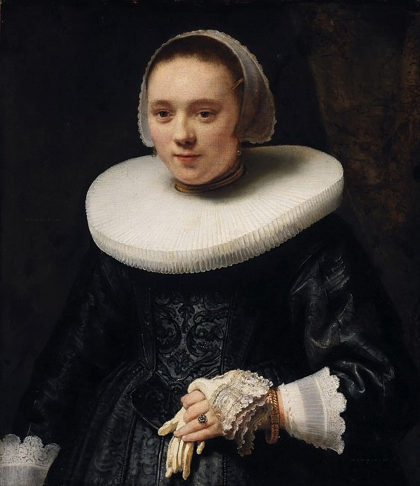 Portrait of a woman holding a glove. Rembrandt Harmenszoon Van Rijn (circle)