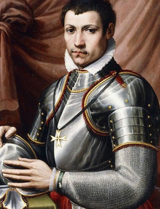 Portrait of a Knight of Malta, half-length, in armour, holding a helmet on a table. Giorgio Vasari