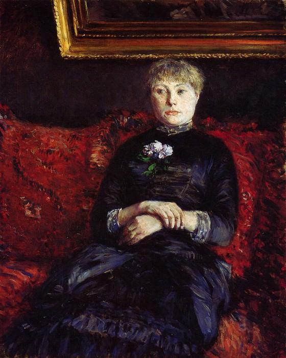 Женщина, сидящая на красной в цветочках софе. Гюстав Кайботт