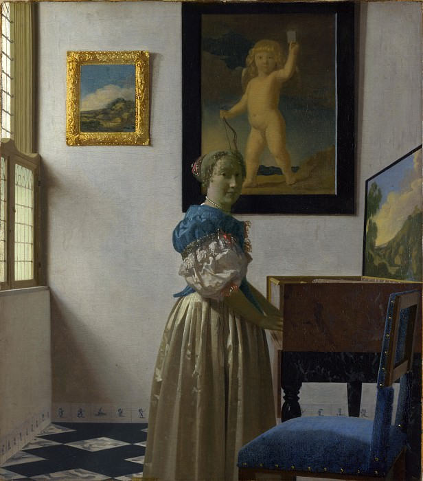 A Young Woman standing at a Virginal. Johannes Vermeer
