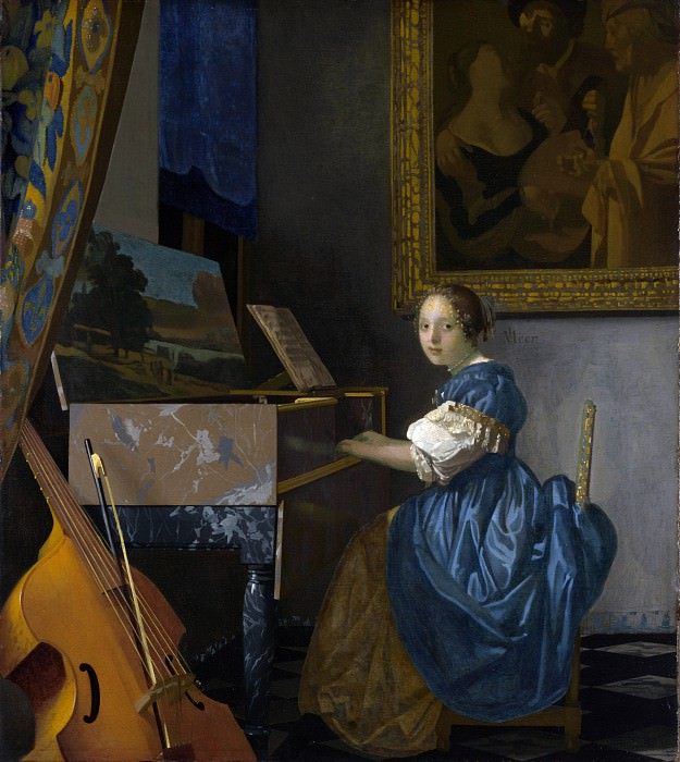 A Young Woman seated at a Virginal. Johannes Vermeer